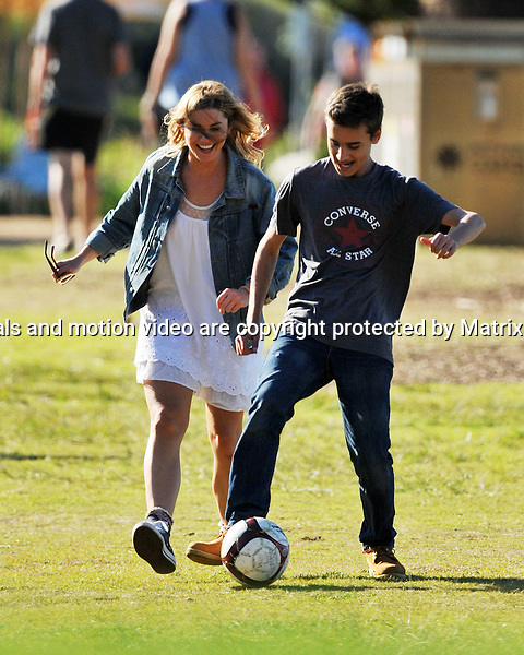 2nd July, 2014 SYDNEY AUSTRALIA<br /> EXCLUSIVE <br /> Pictured, Will McDonald and Phillipa Northeast engage in a bit of soccer after a lunchbreak  during a shoot at the location for Summer Bay on Sydneys Palm Beach, NSW<br /> <br /> *No internet without clearance*.MUST CALL PRIOR TO USE +61 2 9211-1088. Matrix Media Group.Note: All editorial images subject to the following: For editorial use only. Additional clearance required for commercial, wireless, internet or promotional use.Images may not be altered or modified. Matrix Media Group makes no representations or warranties regarding names, trademarks or logos appearing in the images.