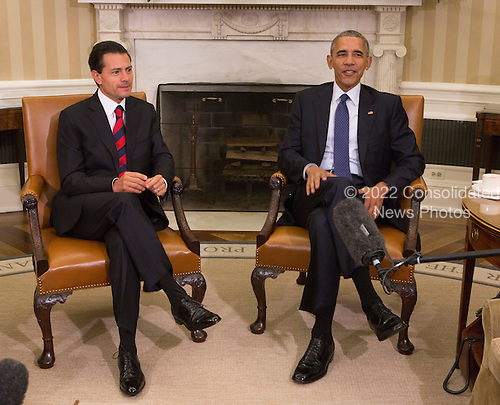 United States President Barack Obama, right, meets with President Enrique Pe&ntilde;a Nieto of Mexico, left, in the Oval Office of the White House in Washington, DC, July 22, 2016.<br /> Credit: Chris Kleponis / Pool via CNP