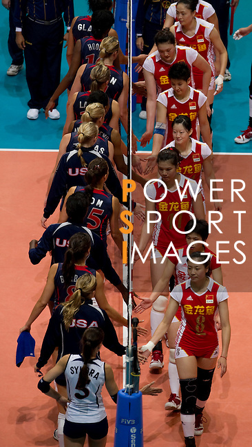 22 August 2010, Hong Kong, China ---  USA and China players sake hand after their volleyball game against China on the last day of the FIVB World Grand Prix Pool G at the Hong Kong Coliseum stadium. Photo by Victor Fraile --- Image by © Victor Fraile