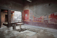 Atrium of the Casa di Fabio Amandio, or House of Fabius Amandus, with frescoes in the Fourth Style of Roman wall painting, 60-79 AD, an iron water drum and a section of mosaic floor, Pompeii, Italy. Pompeii is a Roman town which was destroyed and buried under 4-6 m of volcanic ash in the eruption of Mount Vesuvius in 79 AD. Buildings and artefacts were preserved in the ash and have been excavated and restored. Pompeii is listed as a UNESCO World Heritage Site. Picture by Manuel Cohen