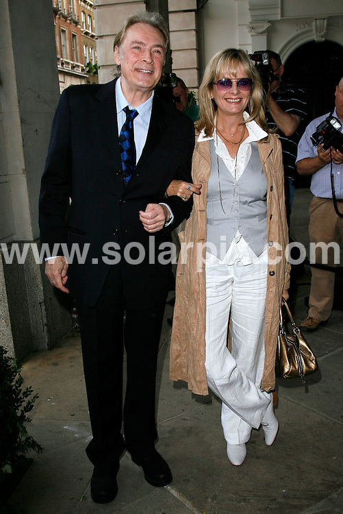 ALL ROUND PICTURES FROM SOLARPIX.COM.**WORLDWIDE RIGHTS*.Twiggy and husband Leigh Lawson arrive for the Marks and Spencer Autumn/Winter 2007 preview at One Piazza, Covent Garden, London..REF:3993   PRS        DATE: 24/05/07.**MUST CREDIT SOLARPIX.COM OR DOUBLE FEE WILL BE CHARGED* *UNDER NO CIRCUMSTANCES IS THIS IMAGE TO BE REPRODUCED FOR ANY ONLINE EDITION WITHOUT PRIOR PERMISSION*