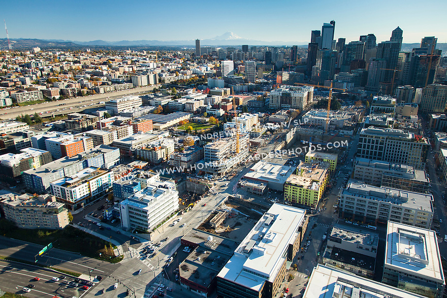 Aerial view of Seattle's South Lake Union neighborhood with the BioMed Realty Research Center in the foreground and the downtown skyline and Mount Rainier in the background