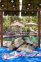 Sun loungers and daybeds beside the swimming pool at the Singita Pamushana Lodge, Malilongwe Trust, Zimbabwe