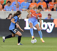 Carli Lloyd (10) of the Houston Dash stops and backs up the ball to keep it away from Danielle Colaprico (24) of the Chicago Red Stars in the first half on Saturday, April 16, 2016 at BBVA Compass Stadium in Houston Texas.