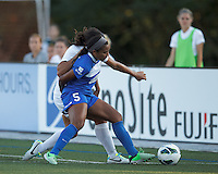 Boston Breakers defender Jazmyne Avant (5) on defense, shields the ball. In a National Women's Soccer League (NWSL) match, Boston Breakers (blue) tied Western New York Flash (white), 2-2, at Dilboy Stadium on August 3, 2013.