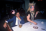 Titanic Club London 1983. New Romantic punk woman with Asian businessman she is knocking over a glass of juice. 1980s UK