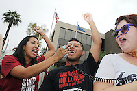 Phoenix, Arizona. April 25, 2012 - Hugo Sanchez (center), one of the undocumented students arrested on March 20, 2012, addresses the crowd. About 500 people protested the controversial law on the same day U.S. Supreme Court justices heard legal arguments on the Arizona vs. United States case. At the end of the march, six activists blocked Central Avenue by sitting in the middle of the street. They all were arrested by the Phoenix Police Department and taken to the Fourth Avenue County Jail. Photo by Eduardo Barraza © 2012