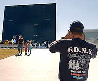 Photo by Rick WIlson--2/1/03--Ron Laliberte of Orlando, Fl., a former New York City resident, takes a photograph of the Astronauts Memorial inside the grounds of the John F. Kennedy Space Center Visitors Complex following the Columbia tragedy. Laliberte was wearing a F.D.N.Y. shirt becasue he had two firefighting friends that lost their lives on 9/11. Laliberte said that he has yet gotten over 9/11 and that Saturday's Space Shuttle Columbia disaster is a tough blow...