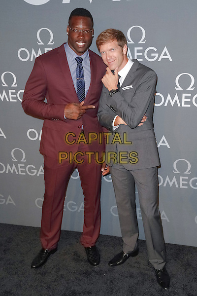 New York, NY - June 10 : Jason Pierre-Paul (L) and Jean Pascal Perret attend the OMEGA Speedmaster Dark Side<br /> of the Moon Launch Event held at Cedar Lake on June 10, 2014 in New York City.  <br /> CAP/MPI/BNC<br /> &copy;Brent N. Clarke / MediaPunch/Capital Pictures