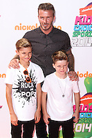 WESTWOOD, LOS ANGELES, CA, USA - JULY 17: Romeo Beckham, David Beckham, Cruz Beckham at the Nickelodeon Kids' Choice Sports Awards 2014 held at UCLA's Pauley Pavilion on July 17, 2014 in Westwood, Los Angeles, California, United States. (Photo by Xavier Collin/Celebrity Monitor)