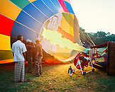 SRI LANKA, Asia, people operating a flame to fill a hot-air balloon