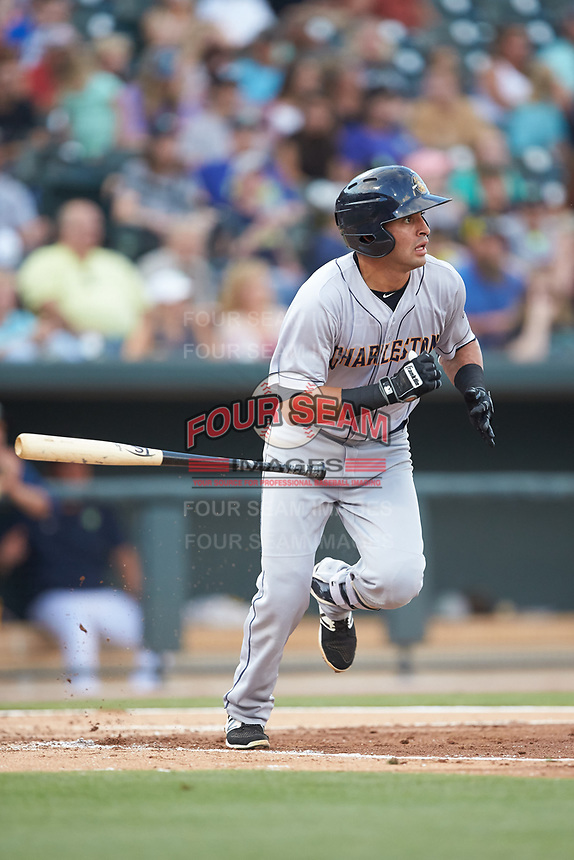 Angel Aguilar (2) of the Charleston RiverDogs tosses his bat as he starts down the first base line against the Columbia Fireflies at Spirit Communications Park on June 9, 2017 in Columbia, South Carolina.  The Fireflies defeated the RiverDogs 3-1.  (Brian Westerholt/Four Seam Images)