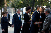 United States President Barack Obama and First Lady Michelle Obama, along with former U.S. President George W. Bush and former First Lady Laura Bush, greet family members and local dignitaries at the National September 11 Memorial in New York, New York, on the tenth anniversary of the 9/11 attacks against the United States, Sunday, September 11, 2011. .Mandatory Credit: Pete Souza - White House via CNP
