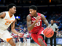 NWA Democrat-Gazette/CHARLIE KAIJO Arkansas Razorbacks forward Darious Hall (20) dribbles past Tennessee Volunteers guard Jordan Bowden (23) during the Southeastern Conference Men's Basketball Tournament semifinals, Saturday, March 10, 2018 at Scottrade Center in St. Louis, Mo. The Tennessee Volunteers knocked off the Arkansas Razorbacks 84-66