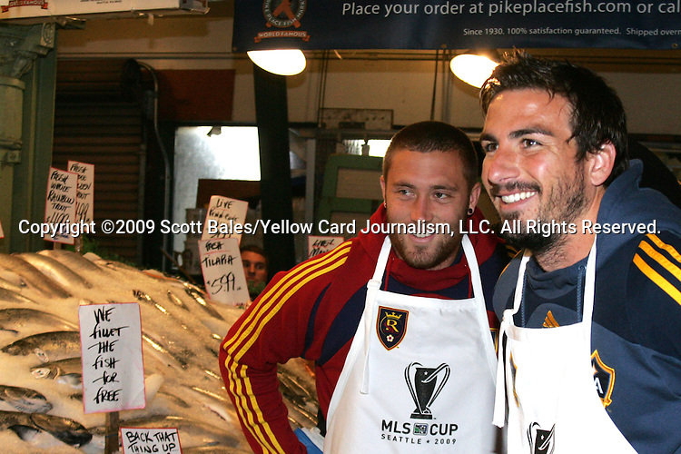 20 November 2009: Alan Gordon (right) of the Los Angeles Galaxy and Chris Seitz (left) of Real Salt Lake. Major League Soccer players Alan Gordon of the Los Angeles Galaxy and Chris Seitz of Real Salt Lake took part in a fish toss at Pike Place Market in Seattle, WA as part of the Major League Soccer MLS Cup weekend activities.