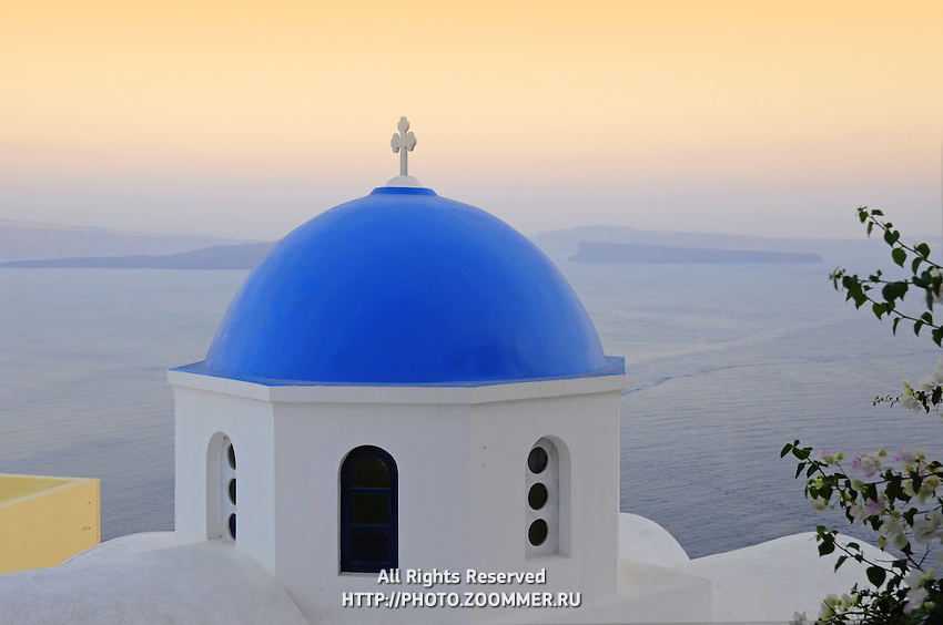 Blue dome of orthodox church in Oia town, Santorini