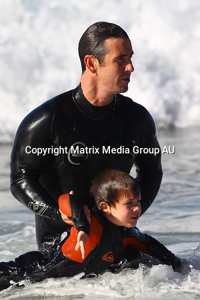 6 JULY 2013 SYDNEY AUSTRALIA<br /> <br /> EXCLUSIVE PICTURES<br /> <br /> Andrew 'Joey' Johns has fun at the beach with his two sons Samuel and Louis Byron Johns