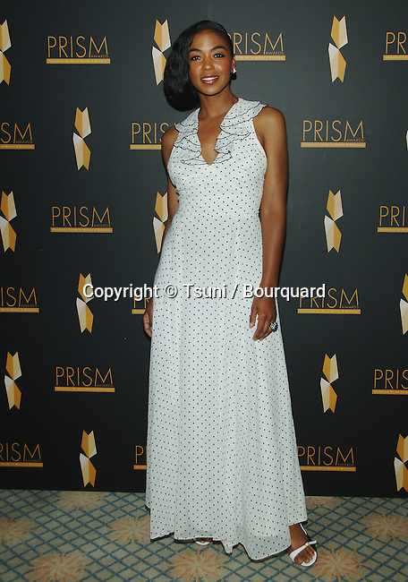Ananda Lewis  arriving at the PRISM AWARDS 2007 at the Beverly Hills Hotel in Los Angeles.<br /> <br /> full length<br /> eye contact<br /> smile<br /> white dress with dots