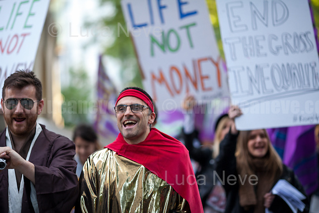 London, 10/05/2017. Today &quot;Life Not Money at the LSE&quot; held a demonstration outside the London School of Economics and Political Science to protest against &quot;the pay and conditions of the lowest paid workers at the school&quot;. From the organiser Facebook event page: &lt;&lt;Noam Chomsky has send us a message to say the campaign is &quot;important and courageous&quot;. [&hellip;] The Life not Money campaign demand for a significant &pound;100,000 cut in LSE director&rsquo;s pay and the money to be used improve the pay and conditions of the lowest paid workers at the school. The last director got around &pound;500,000 while some workers get as little as &pound;8/hour taking into account unpaid breaks. The UVW trade union campaign has exposed a trail of abuse and humiliation experienced by LSE cleaners while the schools excludes working class students so as to accept the off springs of the world's elites. Public institutions such as LSE should be accountable to the general public not a get rich quick scheme for corporate managements. This protest is part of a series of creative events involving the decorating of walls with flowers and balloons and statements. [&hellip;] There have also been peaceful acts of open civil disobedience &ndash; putting washable chalk on the buildings which has led to arrests and bail conditions. [&hellip;] Life not Money is a pop up public campaign to bring people together who are want to take effective and creative action on gross inequality and corruption in our public institutions [&hellip;]&gt;&gt;. The main banner of the protest stated: &quot;You can imprison us but the real crime is inequality&quot;.<br />