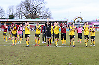 Northampton Town players applaud the travelling fans after the Sky Bet League 2 match between Stevenage and Northampton Town at the Lamex Stadium, Stevenage, England on 19 March 2016. Photo by David Horn / PRiME Media Images.