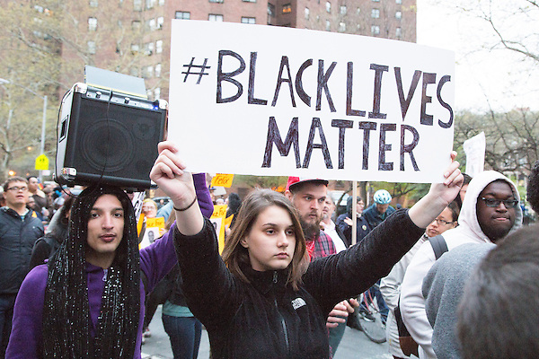 Protesters march through New York City to stand with the people of Baltimore after the murder of Freddie Gray and in solidarity with the May 1st Coalition for Immigrant and Workers Rights on May 1st, 2015.