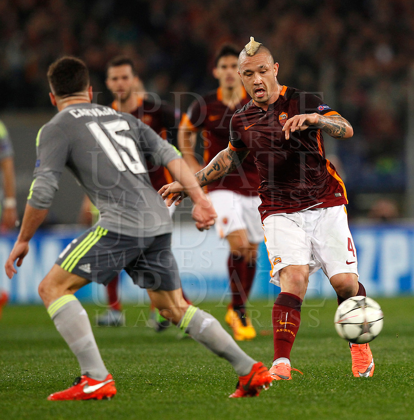 Calcio, andata degli ottavi di finale di Champions League: Roma vs Real Madrid. Roma, stadio Olimpico, 17 febbraio 2016.<br /> Roma's Radja Nainggolan, right, is challenged by Real Madrid's Dani Carvajal during the first leg round of 16 Champions League football match between Roma and Real Madrid, at Rome's Olympic stadium, 17 February 2016.<br /> UPDATE IMAGES PRESS/Riccardo De Luca