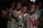 Children sing during Catholic Mass in Lugi, a village in the Nuba Mountains of Sudan. The area is controlled by the Sudan People's Liberation Movement-North, and frequently attacked by the military of Sudan.