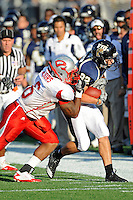 9 October 2010:  FIU wide receiver Greg Ellingson (82) is forced out of bounds by Western Kentucky linebacker Thomas Majors (6) in the third quarter as the FIU Golden Panthers defeated the Western Kentucky Hilltoppers, 28-21, at FIU Stadium in Miami, Florida.