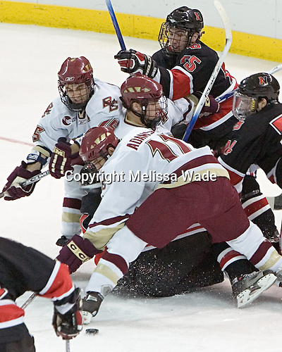 Brian Deeth, Stephen Gionta, Chris Collins, NU ?, Joe Adams, Denis Chisholm - The Boston College Eagles defeated Northeastern University Huskies 5-3 on Saturday, November 19, 2005, at Kelley Rink in Conte Forum at Chestnut Hill, MA.