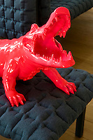 The red crocodile on a sofa in the living room is by Richard Orlinski