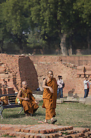 Buddhist monks at Dhamek Stupa monument one of four pilgrimage sites designated by Siddhartha Gautama Buddha<br />