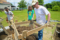 HAZLETON, PA - JUNE 30:  Mike Roller (L), Jonathan Nick (C) and Adam Yeager (R) work at the site of an archaeologic dig June 30, 2014 in Hazleton, Pennsylvania. The team is looking through sites connected with the Lattimer Massacre which occurred in 1897. (Photo by William Thomas Cain/Cain Images)