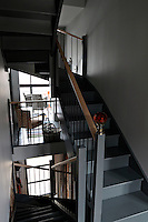 The contemporary staircase is a feature of the house and is punctuated with red crystal newel posts