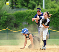 Council Rock North's shortstop Taylor Briggs makes a throw to first after forcing out William Tennent's Sara Keeny at second base Monday May 18, 2015 at Council Rock North in Newtown, Pennsylvania. William Tennent defeated Council Rock North 4-0 in the first-round District One Class AAAA softball playoff game. (Photo by William Thomas Cain/Cain Images)