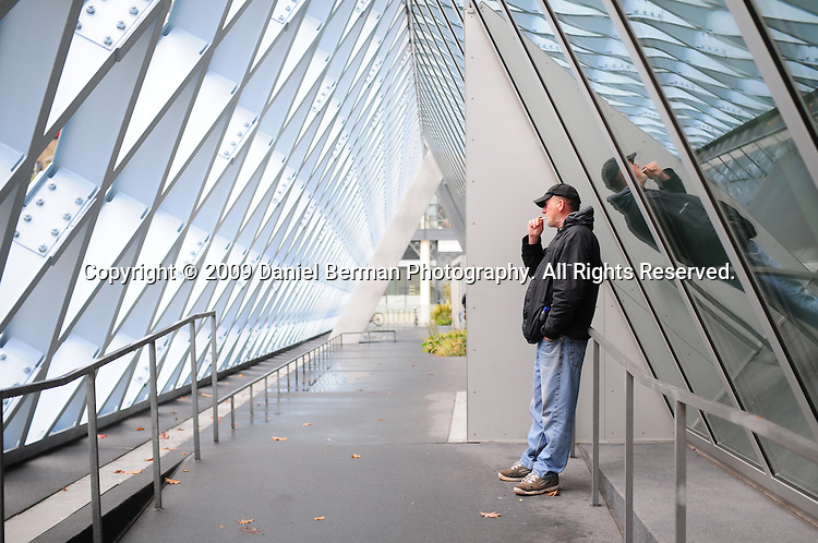 A man stands outside of the downtown Seattle Central Library. The 11-story building opened in 2004, and was designed by Rem Koolhaas. Photo by Daniel Berman/www.bermanphotos.com