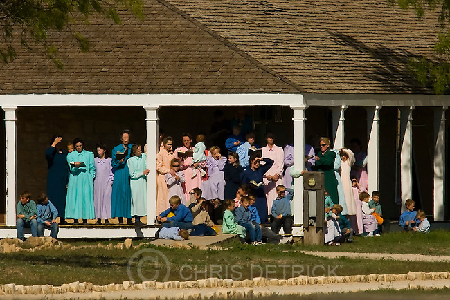 San Angelo, Texas --4/13/08--.FLDS women listen and sing along as FLDS boys sing hymns to them outside at Fort Concho in San Angelo, Texas, where they are being housed temporarily...************.   ..Photo by Chris Detrick/The Salt Lake Tribune..