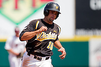 Kevin Hall (18) of the Wichita State Shockers rounds third base during a game against the Missouri State Bears on April 9, 2011 at Hammons Field in Springfield, Missouri.  Photo By David Welker/Four Seam Images