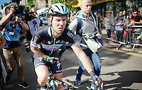 with fear for a broken collarbone/intense pain in the shoulder Mark Cavendish (GBR/OmegaPharma-Quickstep) rides back to the teambus after he crashed hard in the final sprint (where he also took Simon Gerrans down)<br /> <br /> 2014 Tour de France<br /> stage 1: Leeds - Harrogate (190.5km)