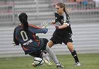 BOYDS, MARYLAND - July 21, 2012:  Ashley Herndon (19) of DC United Women moves the ball past Marbel Egwuenu (0) of the Virginia Beach Piranhas during a W League Eastern Conference Championship semi final match at Maryland Soccerplex, in Boyds, Maryland on July 21. DC United Women won 3-0.