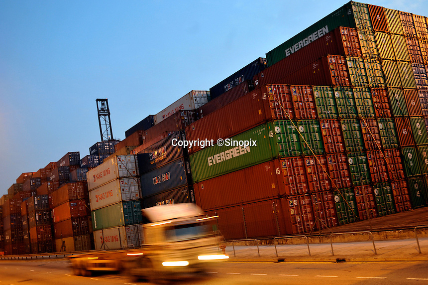 Shipping containers are stacked next to a road-way close to the Hong Kong container terminal and port area, Hong Kong. Hong Kong has seen a near 20% decrease in exports since the financial crisis. .