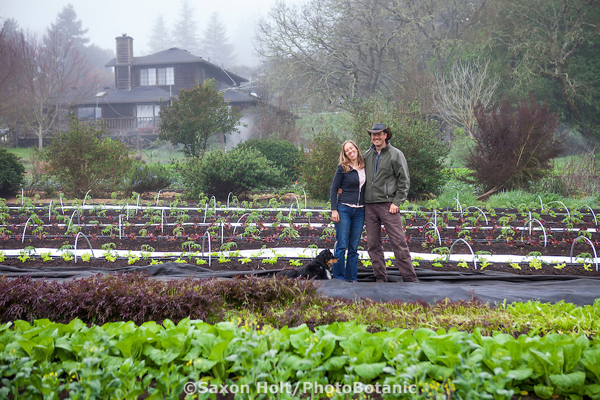 Elizabeth and Paul Kaiser in spring field of vegetables at their Singing Frogs Farm, Sebastopol, California