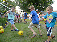 NWA Democrat-Gazette/BEN GOFF &bull; @NWABENGOFF<br /> Children kick balls around at the HappyFeet/Legends Soccer Club booth on Friday Aug. 7, 2015 during the Back to School Celebration First Friday on the Bentonville square.