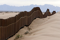 2/15/08- The new border fence , seen from the Mexican side of the border East of San Luis,  runs through sand dunes Feb. 15, 2008. (Pat Shannahan/ The Arizona Republic)