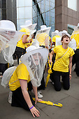 LONDON, England - S'warm, National Youth Theatre Actors in Race to Save Honeybees, Flashmob-style performances on London Bridge and the Monument