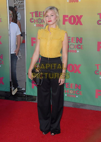 KRISTEN BELL.At The 2006 Teen Choice Awards - Arrivals, .held at The Universal Ampitheatre in Universal City, California, USA, August 20th 2006..full length yellow mustard ruffle shirt blouse tucked into black high waisted trousers bag.Ref: DVS.www.capitalpictures.com.sales@capitalpictures.com.©Debbie VanStory/Capital Pictures