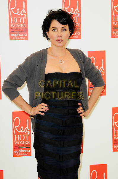 SADIE FROST .attends Red magazine's 'Red Hot Women Awards' at the Saatchi Gallery, London, England, UK, .November 30th 2010..half length hands on hips black dress grey gray cardigan silver necklace .CAP/CAS.©Bob Cass/Capital Pictures.