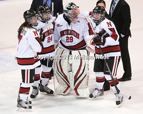 Brittany Esposito (NU - 7), Chelsey Goldberg (NU - 24), Chloe Desjardins (NU - 29), Paige Savage (NU - 28) - The Northeastern University Huskies defeated the Boston University Terriers 4-1 in the opening round of the 2013 Beanpot on Tuesday, February 5, 2013, at Matthews Arena in Boston, Massachusetts.