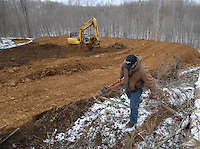A surveyor for International Coal Group prepares the placement of a vent hole to be drilled into Sago mine near Buckhannon, WV, Saturday, Jan. 7, 2006, where 12 miners were killed in an explosion in the ICG mine Monday. (Photo by Gary Gardiner)<br />