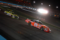 Apr 22, 2006; Phoenix, AZ, USA; Nascar Nextel Cup driver Tony Stewart of the (20) Home Depot Chevrolet Monte Carlo leads Greg Biffle during the Subway Fresh 500 at Phoenix International Raceway. Mandatory Credit: Mark J. Rebilas-US PRESSWIRE Copyright © 2006 Mark J. Rebilas.