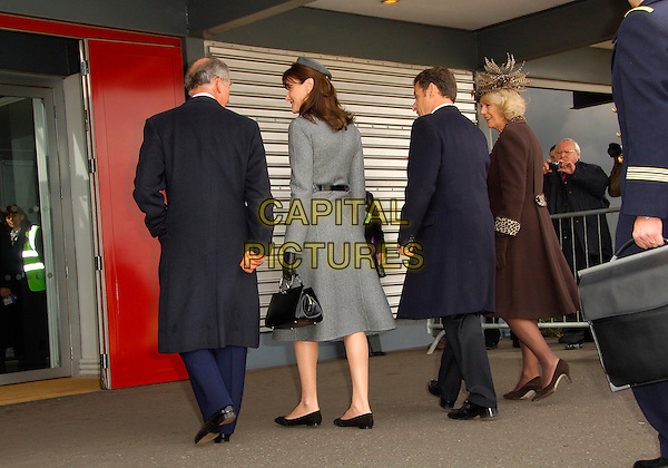HRH PRINCE CHARLES OF WALES, CARLA BRUNI, FRENCH PRESIDENT NICOLAS SARKOZY & CAMILLA PARKER BOWLES, DUCHESS OF CORNWALL.Arrive at Heathrow airport for his first official visit to the UK..March 26th, 2008.full length married husband wife brown black grey gray coat jacket politics royalty back behind rear brown feathers bag purse .CAP/CAS.©Bob Cass/Capital Pictures.